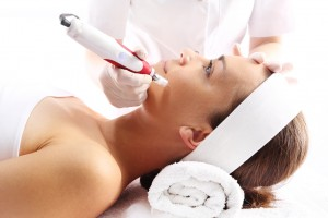 Woman receiving microneedling treatment